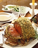 Herb Crusted Rib Roast Partially Sliced on a Platter