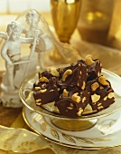 Cashew Nut Chocolate Fudge on a Dish, Statue and Ribbon