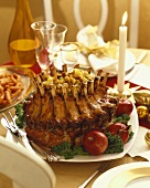 Stuffed Pork Crown Roast on a Platter on Dinner Table
