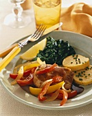 Boneless Pork Chops with Bell Peppers, Polenta and Spinach on a Plate