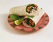 Vegetarian Wrap with Rice, Beans, Lettuce and Tomato, Halved on a Plate