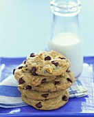Stack of Chocolate Chip Walnut Brownies with a Pitcher of Milk
