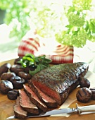 Partially Sliced Grilled London Broil with Grilled Mushrooms, Cutting Board