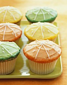 Orange, Green and Yellow Frosted Cupcakes with Sugar Crystals and Icing