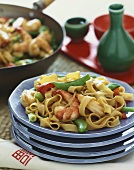 Asian Shrimp Stir Fry with Noodles on a Stack of Blue Plate