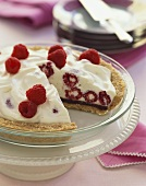 Raspberry Ice Cream Pie with Slice Removed in Baking Dish