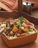 Sweet Potato Stew Over Couscous in a Square Dish, Spoon