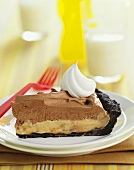 Slice of Chocolate Peanut Butter Pie With Whipped Cream, Plastic Fork