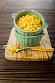 Macaroni and Cheese in a Bowl Stacked in a Bowl; Fork