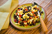Small Plate of Corn and Black Bean Salad with a Spoon