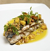 Fish with mango sauce and croutons