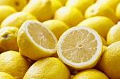 Many Whole Fresh Lemons; One Halved