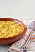 Bowl of Creamed Corn; Spoon on a Napkin