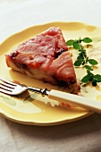 Slice of Apple Upside Down Cake on a Yellow Plate with a Fork