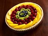Fruit Tart with Mango, Strawberries, Raspberries, Kiwi and Blueberries