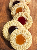 Assorted Jam Filled Peanut Cookies on a Wooden Board
