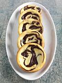 Five Mini Orange Chocolate Swirl Cheesecakes on a Plate