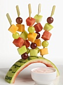 Fruit Skewers Stuck in Watermelon Rind Holder; Raspberry Yogurt Dip