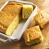 Corn Bread in Baking Dish with Square Pieces Cut Out
