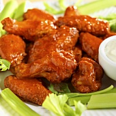 Spicy Buffalo Wings with Blue Cheese Dressing and Celery; Close Up