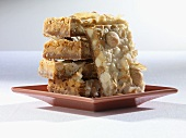 Macadamia, Butterscotch, White Chocolate Coconut Bars; Stacked