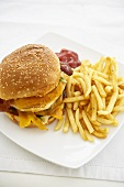 Barbecue Bacon Double Cheeseburger with Fries on a White Plate