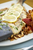 Close Up of Pompano Fish with Lemon and Potatoes