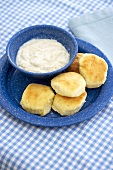 Biscuits on a Plate with a Bowl of Gravy