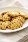 Animal Crackers on a White Plate; Close Up
