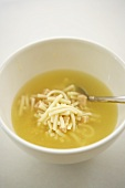 Chicken Noodle Soup in a White Bowl with a Spoon