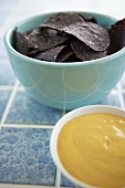 Bowl of Blue Sesame Tortilla Chips with Jalapeno Cheese Dip