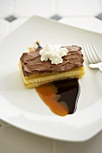 Piece of Boston Cream Pie with Chocolate and Caramel Sauce