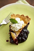 Slice of Blueberry Pie on a Green Plate; Fork