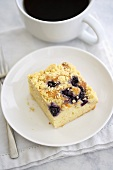 Piece of Blueberry Crumb Coffee Cake with a Cup of Coffee