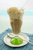 Root Beer Float on a Saucer with Straw and Spoon