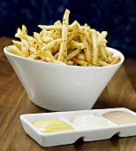 French Fries in White Bowl with Three Different Dips
