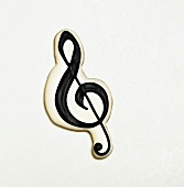 Treble Clef Sugar Cookie on a White Background