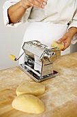 Making Pasta: Putting Pieces of Dough into a Pasta Maker