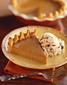 Slice of Pumpkin Pie with a Scoop of Ice Cream