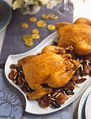 Two Roast Chickens on a Platter with Dried Fruit