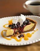 Slice of Cheesecake with Berry Topping and Whipped Cream; Bitten