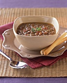 Bowl of Bean Stew with Breadsticks