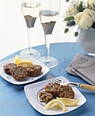 Crab Cakes with Lemon Wedges and Champagne