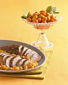 Platter of Sliced Pork Roast with Kumquats