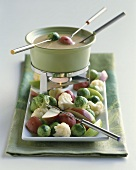 Pot of Fondue with Vegetables and Apple Slices