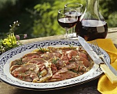 Beef Carpaccio; Red Wine in a Decanter and Glasses