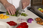 Chef Chopping Assorted Ingredients on a Cutting Board