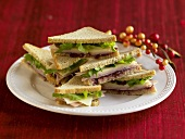 Sandwich Triangles Piled on a Plate