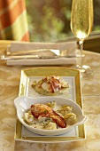 Lobster Tortellini in a White Dish; Glass of Champagne