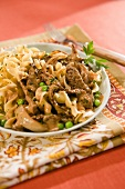 Plate of Beef Stroganoff with Peas
